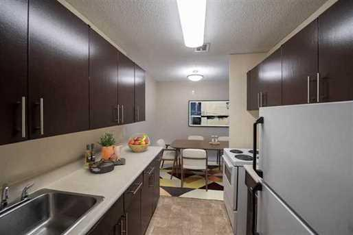 apartment kitchen that includes lots of storage space